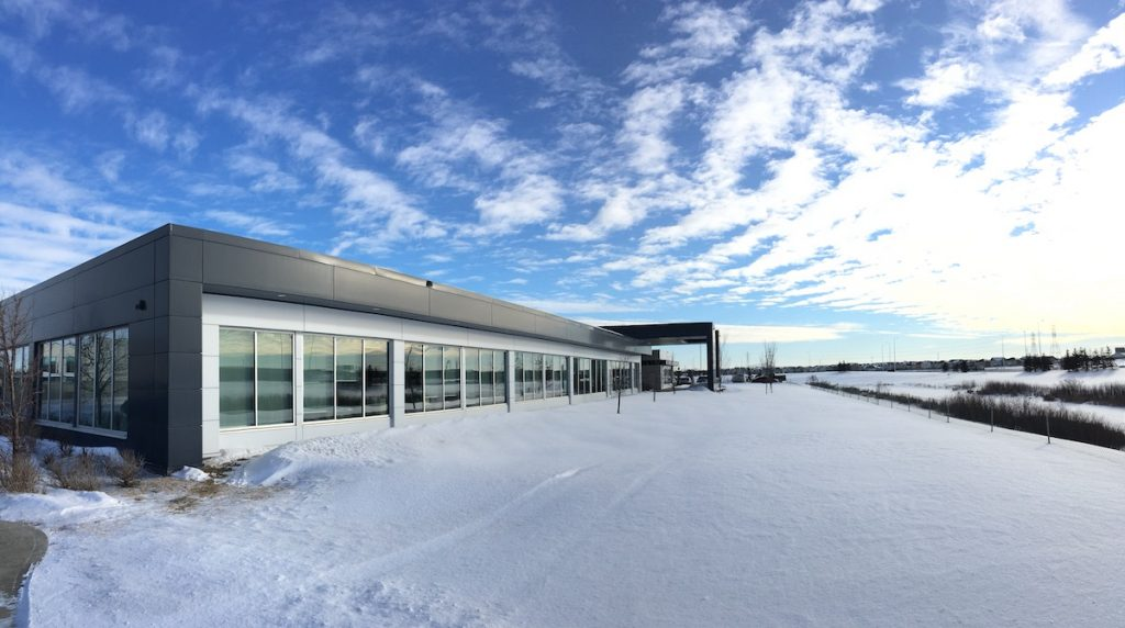 Under a gorgeous Prairie winter sky in February, we moved into this new space!