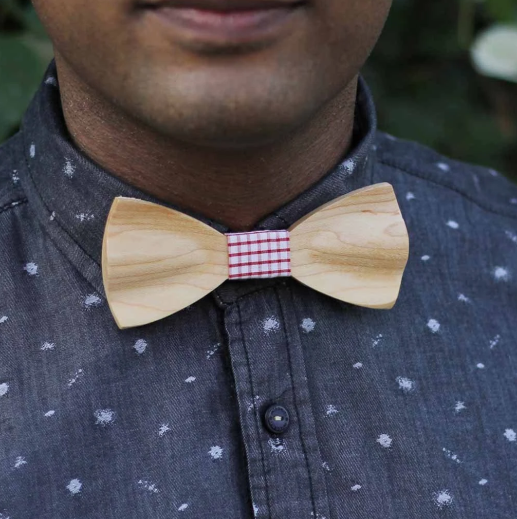Image of man wearing wooden bowtie