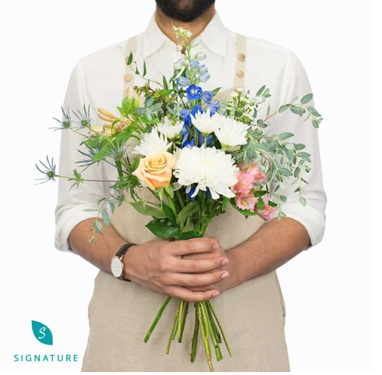 Man holding a beautiful bouquet of flowers